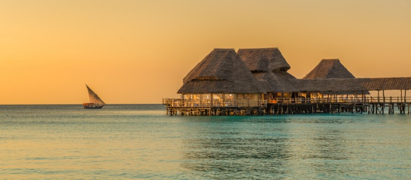 Bar and cafe on water at sunset in Zanzibar, Tanzania